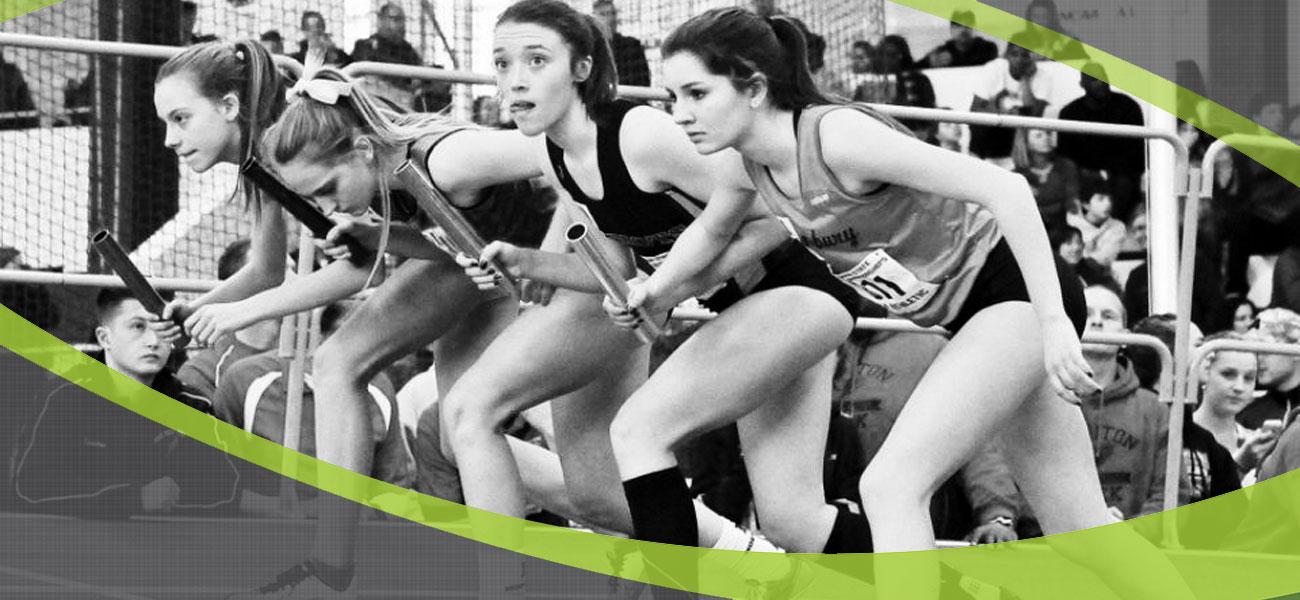 girls running a relay
